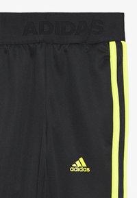 adidas Performance - TIRO STADIUM LEAGUE AEROREADY PANTS - Teplákové kalhoty - black/yellow - 2