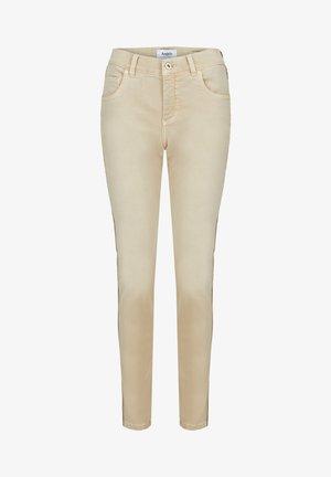 MIT GLITZERGALON - Jeans Skinny Fit - beige