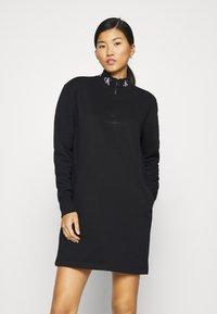 Calvin Klein Jeans - LOGO TRIM MOCK NECK ZIP DRESS - Day dress - black - 0