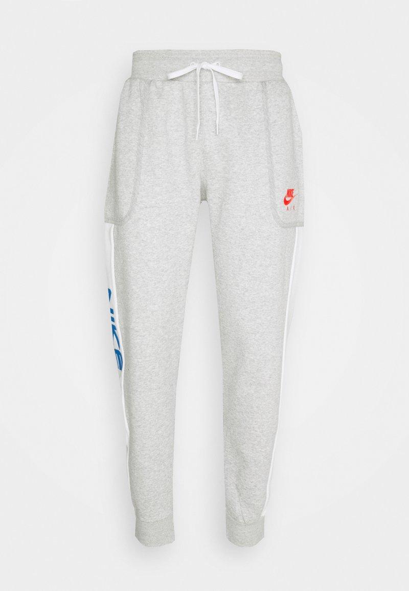 Nike Sportswear - Tracksuit bottoms - grey heather/summit white/infrared