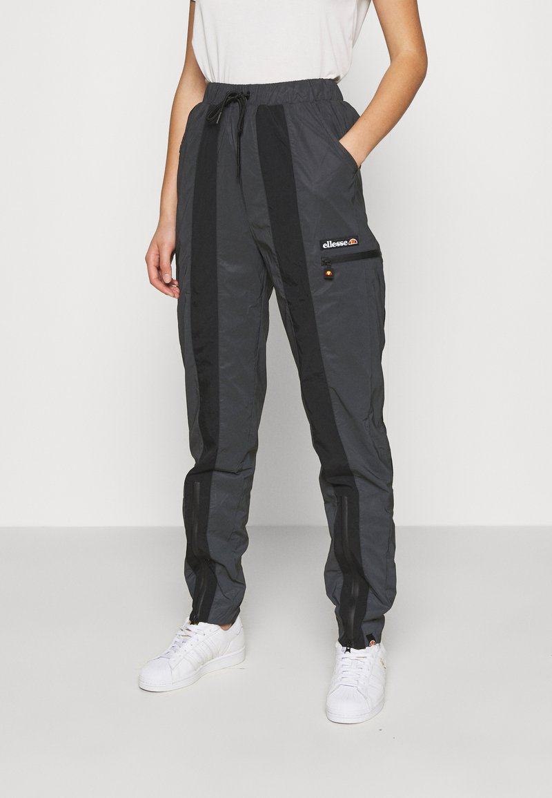 Ellesse - REFLECTIVE EQUES - Tracksuit bottoms - black