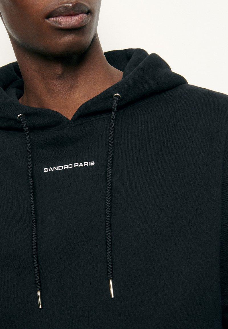 sandro HOODIE - Kapuzenpullover - noir/schwarz 9mUp2Z