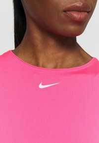 Nike Performance - ALL OVER - Basic T-shirt - hyper pink/white - 5