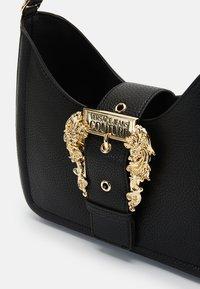 Versace Jeans Couture - BUCKLE SHOULDER BAG - Handbag - nero - 4