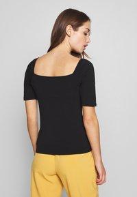 ONLY - ONLSALLY ORGANIC - Camiseta básica - black - 2