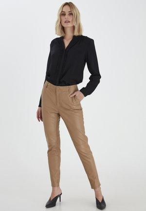 PREMIUM - Leather trousers - tannin