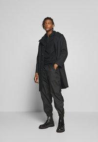 HUGO - DOLDEN - Polo shirt - black - 1