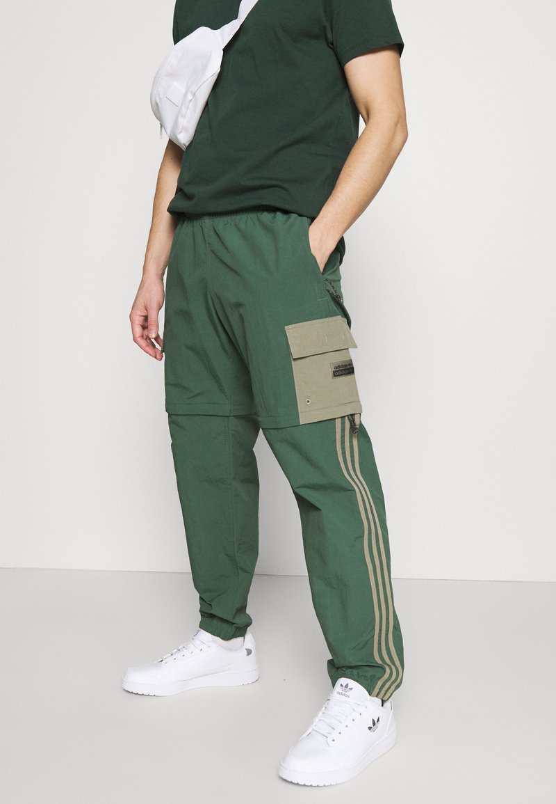 adidas Originals - UTILITY TWO IN ONE ORIGINALS - Cargo trousers - green oxide/clay