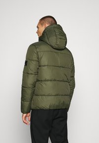 Calvin Klein Jeans - HOODED PUFFER JACKET - Winter jacket - deep depths - 2