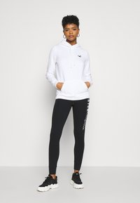 Hollister Co. - LOGO FLEGGINGS - Leggings - Trousers - black - 1