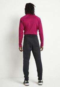 adidas Performance - SPORTSWEAR AEROREADY PANTS - Teplákové kalhoty - black - 3