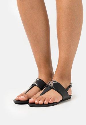 FLAT  - T-bar sandals - black