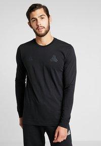 adidas Performance - TAN LOGO TEE - Langærmede T-shirts - black - 0