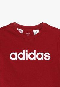 adidas Performance - LIN UNISEX - T-shirt print - active maroon/white - 3