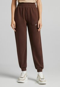 Bershka - MIT PRINT - Pantaloni sportivi - brown - 0