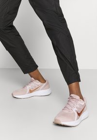Nike Performance - RUN PANT - Pantalones deportivos - black/gold - 4