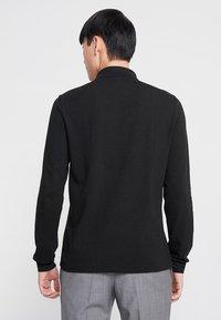 Lacoste - Polo shirt - black - 2