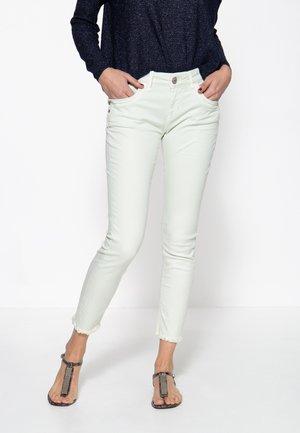 MIT OFFENEN S - Slim fit jeans - mint