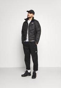 The North Face - SAIKURU JACKET - Winter jacket - black - 1
