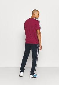 Champion - CUFF PANTS - Teplákové kalhoty - dark blue - 2