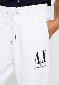 Armani Exchange - PANTALONI - Tracksuit bottoms - white - 3