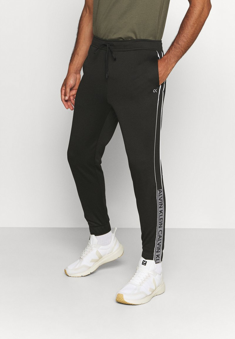 Calvin Klein Performance - PANT - Tracksuit bottoms - black/bright white