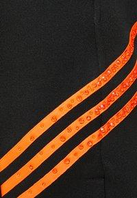 adidas Originals - TRACK PANT UNISEX - Tracksuit bottoms - black/trace orange - 4