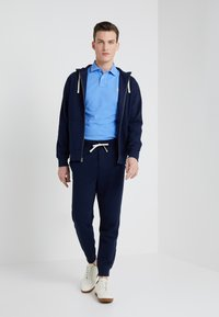 Polo Ralph Lauren - CUFF PANT - Tracksuit bottoms - cruise navy - 1
