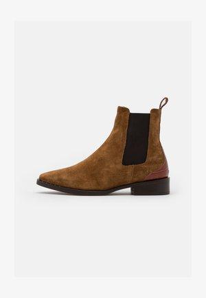 TRONA - Classic ankle boots - cognac