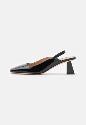 AIRE - Classic heels - black
