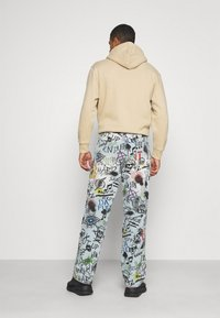 Jaded London - RIPPED GRAFFITI SKATE  - Relaxed fit jeans - blue - 3