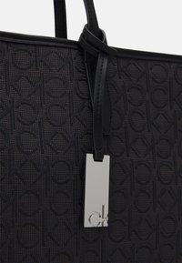 Calvin Klein - SHOPPER LAPTOP POUCH - Tote bag - black - 4