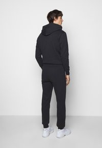 ARKK Copenhagen - BOX LOGO PANTS - Tracksuit bottoms - black - 2
