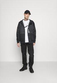 Nike Sportswear - AIR  - Waterproof jacket - black/dark smoke grey/white - 1