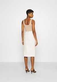 NA-KD - CUT OUT SKIRT - Jupe en jean - light beige - 2