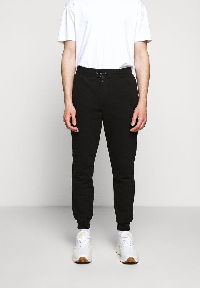Pantalones deportivos - darkest black