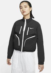 Nike Sportswear - Chaqueta de entrenamiento - black - 0