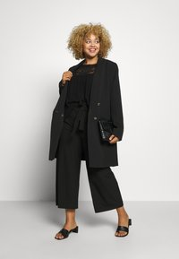 ONLY Carmakoma - CARICOLE CULOTTE WIDE PANTS - Trousers - black - 1