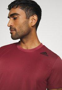 adidas Performance - HEAT.RDY TRAINING SLIM SHORT SLEEVE TEE - Print T-shirt - legend red - 3