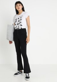 Gina Tricot - Flared jeans - black - 2