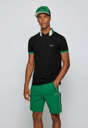 PAULE - Polo shirt - black