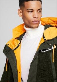 Nike Sportswear - FILL MIX - Übergangsjacke - kumquat/sequoia - 7