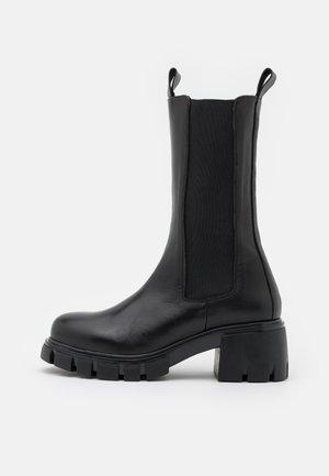 HIGH SHAFT CHELSEA - Platform boots - black