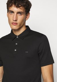 Michael Kors - SLEEK - Polo shirt - black - 3