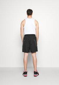 Nike Performance - THROWBACK SHORT NARRATIVE - Sports shorts - black - 2