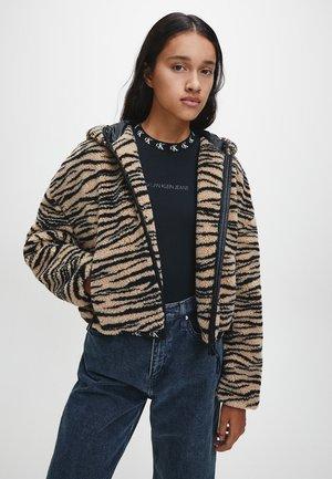 Winter jacket - zebra aop irish cream black