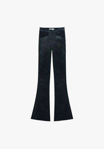 BESCHICHTETE - Pantaloni - mottled black