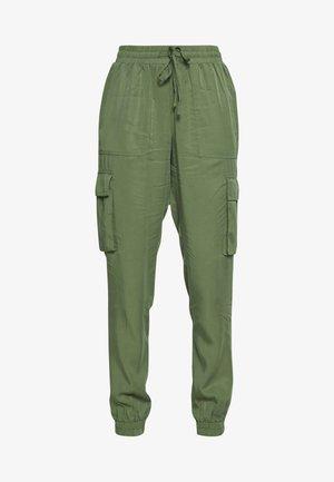 SOFT UTILITY TRACK PANTS - Trousers - dull moss green