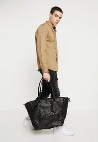 The North Face - STRATOLINE TOTE - Sports bag - black - 1