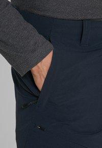 Mammut - RUNBOLD ZIP OFF - Outdoorové kalhoty - black - 3